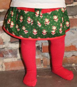 O. Carol jupe de Noël pour bébé petits pères Noël sur fond vert et étoiles dorées