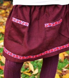 O. carol jupe en velours bordeaux avec poches et ruban décoratif motif pommes